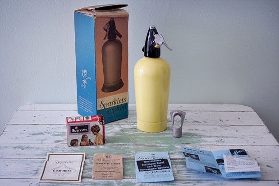 1960s bright yellow Sparklets Syphon Hostmaster seltzer bottle in its original box