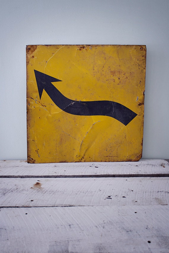 Metal black and yellow arrow road sign
