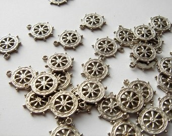 20 pieces of 12 mm vintage Ships wheel charms silver tone HC032.