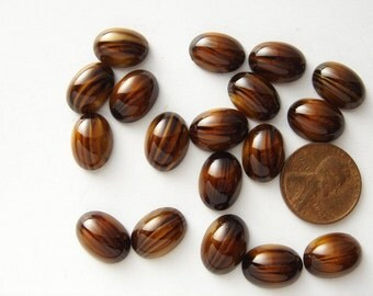 12 vintage glass tiger eye oval cabochons HC040.