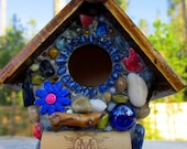 Whimsical garden birdhouse with Colorful Flowers and wine corks