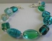 handcrafted aquamarine glass beaded bracelet