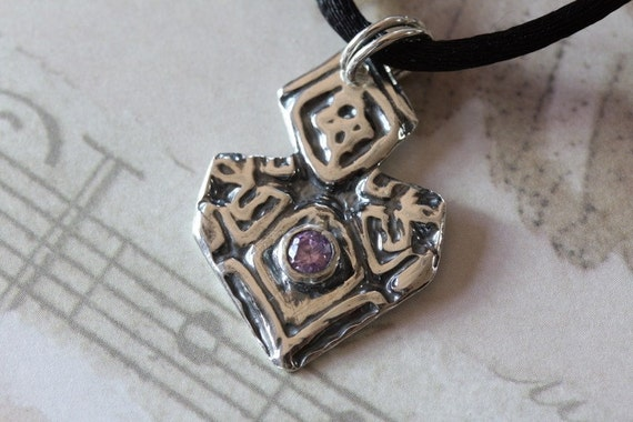 Artisan silver pendant with amethyst colored cubic zirconia