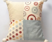 Small pathwork cushion with or without pom poms. 8X8 inchs.