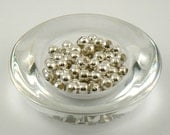 Shiny shiny silver coloured metal beads, destash