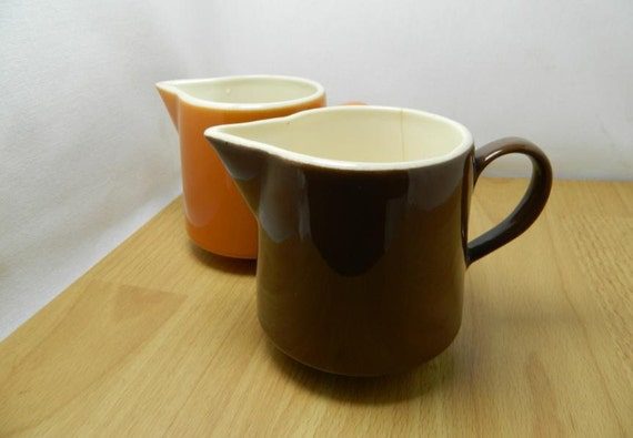 Vintage Set of Two Brown and Orange Creamer Pitchers