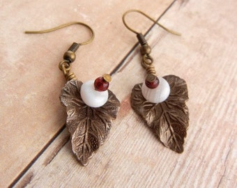 Bronze leaf earrings with white agate gemstones and red accents // nature inspired jewelry