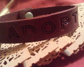 Dog lovers adopt leather bracelet