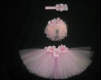 Newborn pink tutu set includes tutu, pink wings, and headband