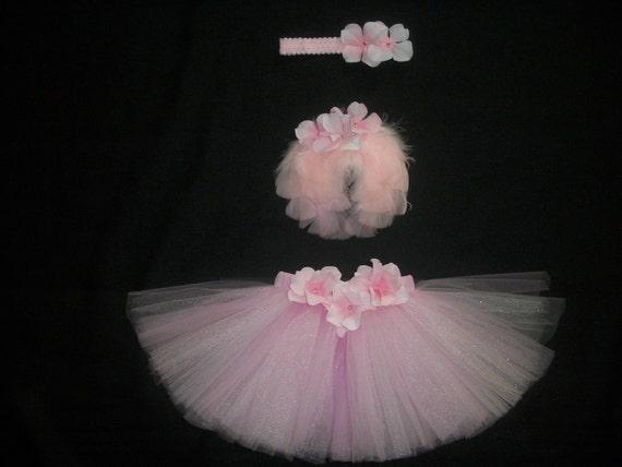Newborn pink tutu set includes tutu, pink wings, and headband