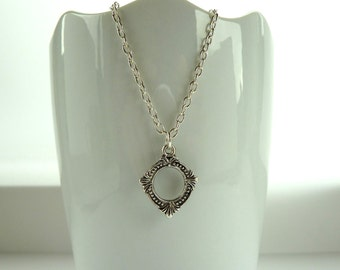 Tibetan silver necklace - Ornate silver circle necklace on silver chain