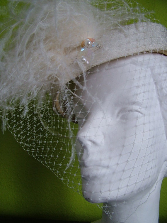 Vintage fascinator hat with rich ostrich feathers added to veiled feather hat
