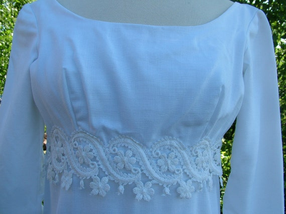 Vintage 1960s empire wedding dress in white cotton linen with stunning lace decoration