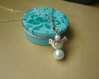 Antique silver mama bird necklace with white and powder blue pearls