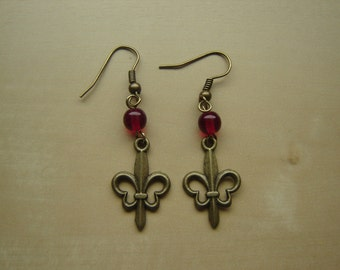 Antique brass fleur-de-lis earrings with red Czech pressed glass beads