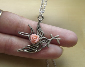 Silver bird necklace with peach resin rose