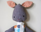 Soft toy bunny with bright spots...