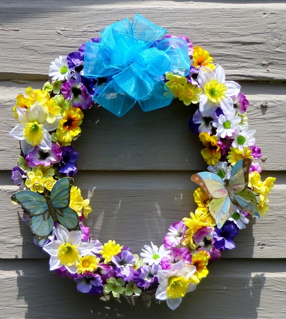 Summer spring grapevine wreath of purple, yellow, pink pansies, yellow daffodils, yellow, white daisies, sheer turquoise bow