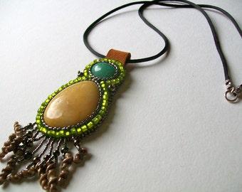 Yellow beaded stone pendant