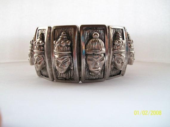 Vintage Siam type Stylized Panels w/ Repousse Heads Bracelet /Silver Expandable