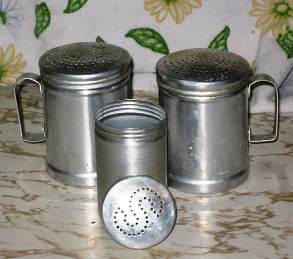 aluminum salt shaker and two shakers with handles