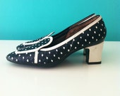 1960's mod black shoes with white x'es and white heel