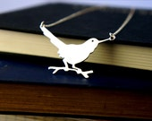 Fine silver blackbird on a branch pendant