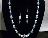 Blue, white pearl necklace with matching earings.
