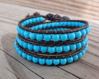Blue Chalk Turquoise Triple Leather Wrap Bracelet with Elephant Button Closure
