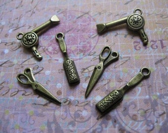 Collection of 6 hair styling charms in bronze tone - C439