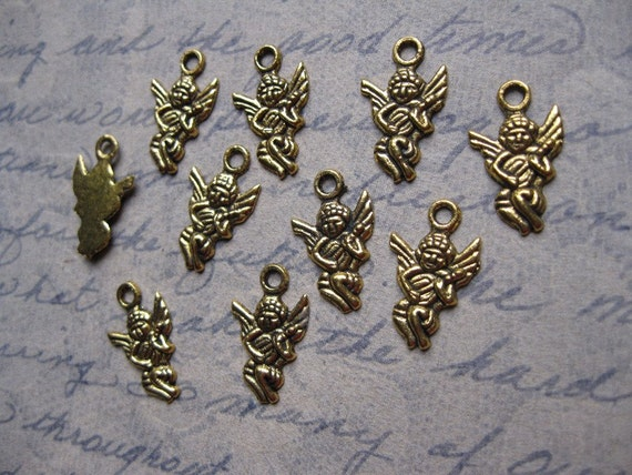 10 Small Cupid Charms in Gold Tone - C101