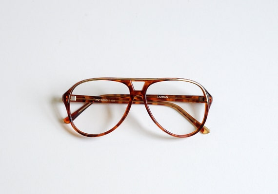 80s aviator plastic glasses, tortoiseshell, gold brow, clear brown orange, geeky nerdy