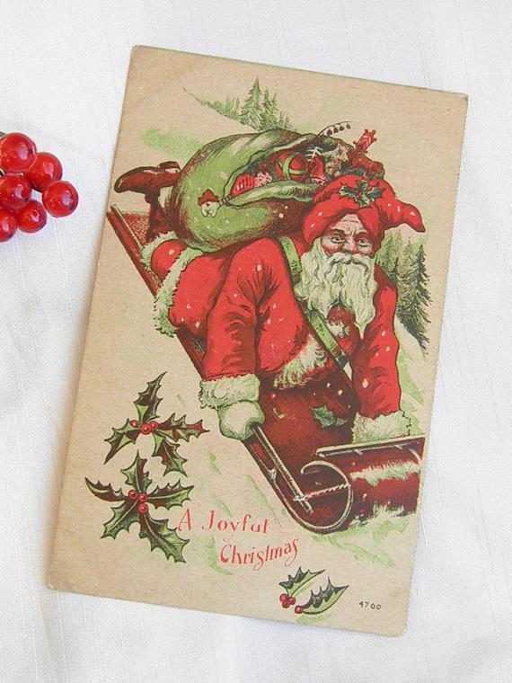 Sledding Santa Vintage Postcard  Circa 1909