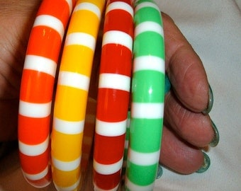 4 striped lucite bangle bracelets, red, yellow, green, orange & white