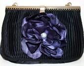 Little black purse with purple satin flower