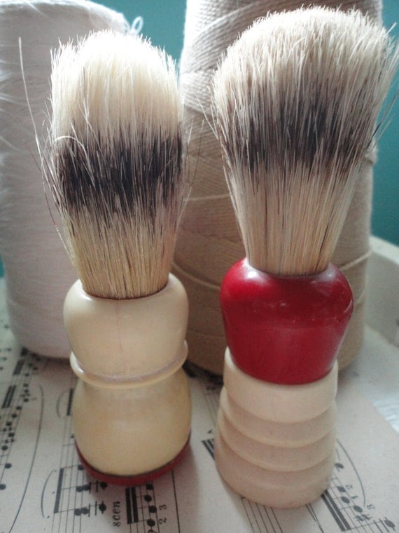 On Reserve  Pair of vintage shaving brushes with red handle accents