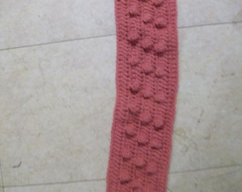 Burgundy colored crocheted scarf