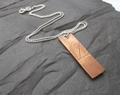 Copper leaf dog tag pendant design oxidised with sterling silver
