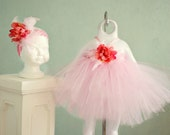 Pink tutu halter Dress w/ pink flower embellishments. Halter tie made with ribbon. Crocheted pink top.  Can be made for 6mths -4T
