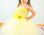 Yellow tutu halter Dress w/ yellow flower embellishments. Crocheted yellow top.  Can be made for 6mths -4T. Prices Vary