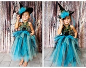 Witch tutu dress. Crocheted top and with peacock feathers and matching witch hat . flower and tulle embellishments
