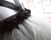 SIlver and black tutu dress. Black crocheted top with black floral trim