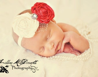 Vintage-inspired Red and Cream handrolled florals with netting and button embellishments.