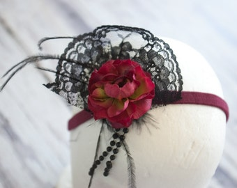 Burgundy headband with feather, lace, and bead embellishments