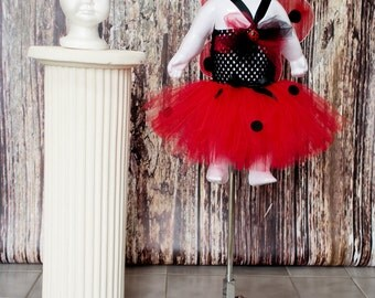 Ladybug tutu dress. Crocheted  top with black felt polka dots. Comes with matching headband with lady bug embellishment