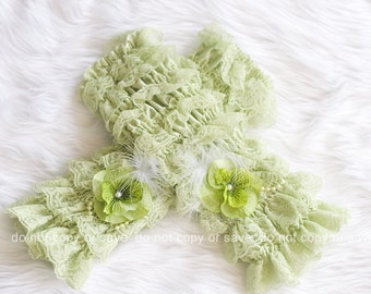 Sage lace legwarmers and contains flower, lace, bead, and feather embellishments.