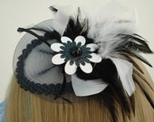OOAK sinamay base fascinator trimmed with a decorative jet bead fringe