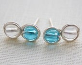 Stud earrings, blue / clear irindescent, nickel free silver plated wire wrap