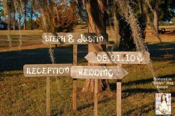 Rustic Wood Wedding Signs Hand painted on Reclaimed Wood...Listing for 4 custom signs & 4 stakes.  Featured in BRIDES MAGAZINE