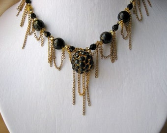 Gold chain disco & black crystal necklace - loops of chain, metal and black ball shaped pendant